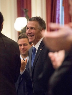 Republican Gov. Phil Scott receives a standing ovation after taking the oath of office during the inauguration ceremony at the Vermont Statehouse in Montpelier, Vt. Thursday, Jan. 5, 2017. (AP Photo/Alden Pellett)