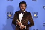 In this Jan. 8, 2017 file photoi, Donald Glover poses in the press room with the award for best performance by an actor in a television series - musical or comedy for 'Atlanta' at the 74th annual Golden Globe Awards at the Beverly Hilton Hotel in Beverly Hills, Calif. (Jordan Strauss / Invision)