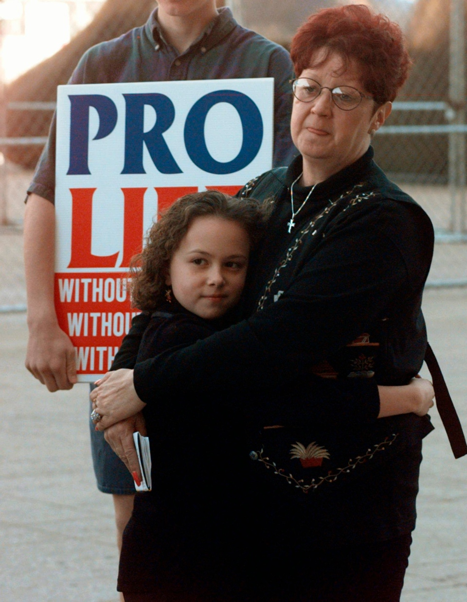 In this Jan. 22, 1997, file photo, Norma McCorvey, right, known as Jane Roe in the landmark U.S. Supreme Court ruling 24 years ago that legalized abortion nationwide, stands with her friend Meredith Champion, 9, at an Operation Rescue rally in downtown Dallas. (AP / Ron Heflin)