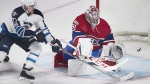 Montreal Canadiens goaltender Carey Price makes a save against Winnipeg Jets' Nikolaj Ehlers during first period NHL hockey action in Montreal, Saturday, February 18, 2017. THE CANADIAN PRESS/Graham Hughes