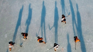 Minor hockey players play a game of shinny on the Rideau Canal Skateway during CIBC Shinny Day, on Saturday, Feb. 18, 2017 in Ottawa. (Justin Tang/The Canadian Press)