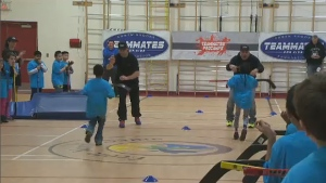 Ryan Smyth and Garth Brooks teamed up to host a hockey camp for elementary kids Saturday.