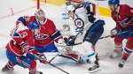 Montreal Canadiens goaltender Carey Price makes a save against Winnipeg Jets' Mark Scheifele (55) as Canadiens' Alexei Emelin (74) and Shea Weber (6) defend during third period NHL hockey action in Montreal, Saturday, February 18, 2017. THE CANADIAN PRESS/Graham Hughes