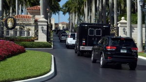 In this file photo, the motorcade with U.S. President Donald Trump and Japanese Prime Minister Shinzo Abe, arrives at Trump International Golf Club in West Palm Beach, Fla., Saturday, Feb. 11, 2017. (AP Photo / Susan Walsh)