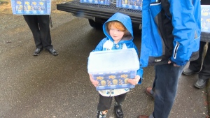 The young boy eagerly awaited the truck's arrival and helped unload the boxes when they arrived. Feb. 18, 2017 (CTV Vancouver Island)