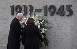 U.S. Vice President Mike Pence, left, and his wife Karen lay a wreath to commemorate the victims of the Nazi terror during a visit to the former Nazi concentration camp in Dachau near Munich, southern Germany, Sunday, Feb. 19, 2017, one day after he attended the Munich Security Conference. (Sven Hoppe / pool photo via AP)
