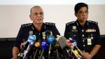 Malaysia Deputy Inspector-General of Police Noor Rashid Ibrahim, left, speaks during a press conference at police headquarters in Kuala Lumpur, Malaysia, Sunday, Feb. 19, 2017.  (AP Photo/Vincent Thian)