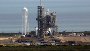 A Space X Falcon9 rocket sits on the launch pad, Saturday, Feb. 18, 2017 at the Kennedy Space Center in Cape Canaveral, Fla Last-minute rocket trouble forced SpaceX on Saturday to delay its inaugural launch from NASA's historic moon pad. (Red Huber/Orlando Sentinel via AP)
