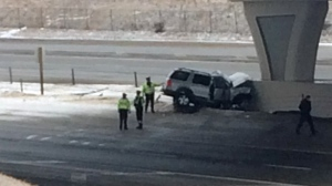Members of the Calgary Police Service at the scene of Sunday morning's fatal crash on Stoney Trail