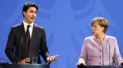 German Chancellor Angela Merkel, right, and the Prime Minister of Canada Justin Trudeau brief the media after talks at the chancellery in Berlin, Friday, Feb. 17, 2017. (AP Photo/Markus Schreiber)