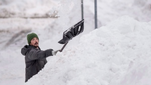 A man clears snow from his driveway in Halifax on Tuesday, February 14, 2017, following a major winter storm that hit the Maritimes. (Darren Calabrese/The Canadian Press)
