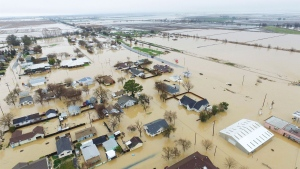 This Saturday, Feb. 18, 2017, aerial photo, shows major flooding in Maxwell, Colusa County, Calif. Water is receding in the farm community of Maxwell, where dozens of people sought higher ground after creeks topped their banks and inundated houses on Friday, said Colusa County Assistant Sheriff Jim Saso said. (Hector Iniguez via AP)