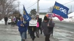 A group gathered outside a Liberal MLA's office in Cape Breton to protest the government's back-to-work legislation.