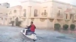 Caught on Cam: Man jet skis through flooded street