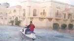 Caught on Cam: Man jet skis through flooded street