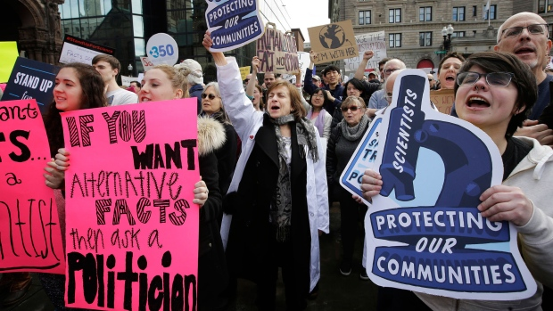 Scientists take to streets to defend research