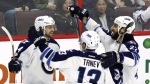 Winnipeg Jets' Josh Morrissey (44) celebrates his goal against the Ottawa Senators with teammates Brandon Tanev (13) and Chris Thorburn (22) during third period NHL hockey action in Ottawa on, Sunday February 19, 2017. THE CANADIAN PRESS/Fred Chartrand