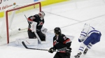 Toronto Maple Leafs' Connor Brown, right, scores against Carolina Hurricanes goalie Cam Ward as Hurricanes' Justin Faulk looks back during the third period of an NHL hockey game in Raleigh, N.C. on Sunday, Feb. 19, 2017. (AP / Gerry Broome)