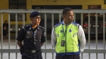 Malaysian police officers guard the gate of the forensic department at Kuala Lumpur Hospital in Kuala Lumpur, Malaysia on Monday, Feb. 20, 2017. (AP / Alexandra Radu)