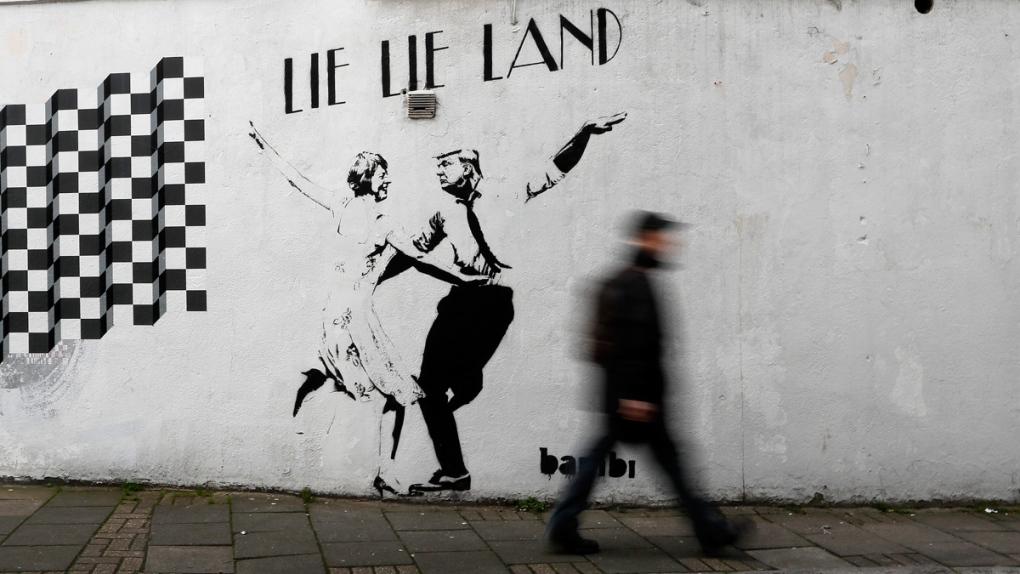 'Lie Lie Land' street art by Bambi in London, U.K.
