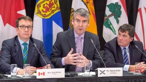 Nova Scotia Premier Stephen McNeil is flanked by Treasury Board President Scott Brison, left, and Fisheries Minister Dominic LeBlanc at the closing news conference at a meeting of Atlantic Canada premiers and several federal ministers to discuss the Atlantic Growth Strategy, in Wolfville, N.S. on Friday, Jan. 27, 2017. (Andrew Vaughan/The Canadian Press)