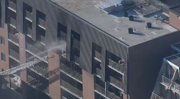 Crews are responding to a three-alarm fire at a highrise apartment building near Dundas and Sherbourne streets.