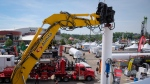 Heavy machinery is on display at the Global Petroleum Show in Calgary, Alta., Tuesday, June 7, 2016. (Jeff McIntosh/The Canadian Press)