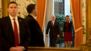 United States Vice President Mike Pence, center left, and European Union High Representative Federica Mogherini, right, are reflected in a mirror as they enter the room prior to a meeting at US ambassadors residence in Brussels on Monday, Feb. 20, 2017. (Virginia Mayo/AP)