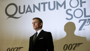 "Daniel Craig poses for photographs in front of a backdrop for the film ""Quantum of Solace.""  (ADRIAN DENNIS/AFP PHOTO)"
