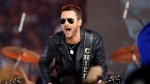Country music singer Eric Church performs at halftime during an NFL football game between the Washington Redskins and Dallas Cowboys in Arlington, Texas on Nov. 24, 2016. (Ron Jenkins/AP)
