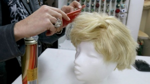 Manuela Plank owner of a costume rental shop fashioning normal blond hairpieces into Trump wigs in Pfaffstaetten, Austria, on Feb. 20, 2017. (Ronald Zak / AP)