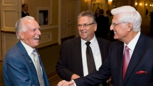 Ed Lumley (right), Chancellor of the University of Windsor, shakes hands with Bob White (left), the first President of the CAW, with Ken Lewenza at a fundraiser roast for the new Centre for Engineering Innovation at the Royal York in Toronto on Wednesday May 30, 2012. (THE CANADIAN PRESS/Aaron Vincent Elkaim)