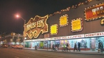 The Honest Ed's neon sign shined at night at the corner of Bathurst and Bloor streets before its doors closed for the final time in Dec. 2016.