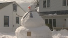 A Halifax couple created this 15-foot snowman with all the snow the city receive this week.
