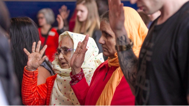 Bhutanese refugees Saraswoti (left) and Sarasota Baral are seen take their public oath for Canadian citizenship during a ceremony at the Maritime Museum of the Atlantic in Halifax, Monday, Feb. 20, 2017. (THE CANADIAN PRESS)