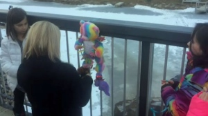 Airdrie residents show their support for the family attaching a colourful teddy bear and flowers to the pedestrian bridge above the canal