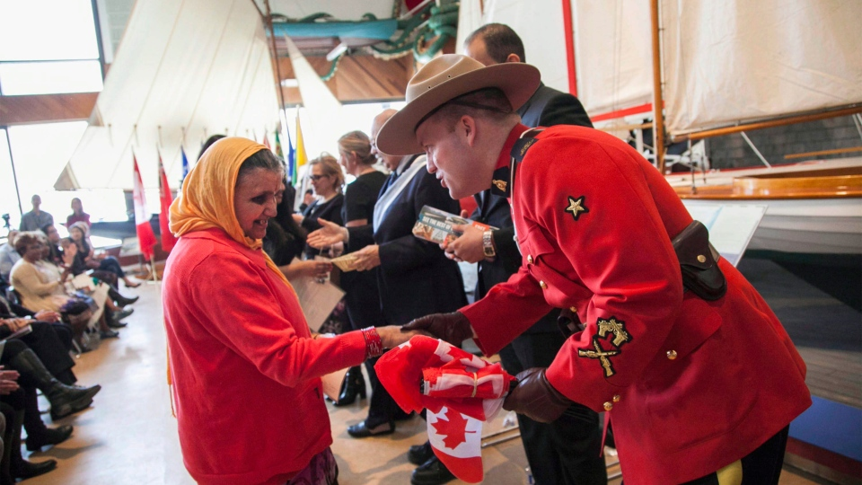 Bhutanese refugee Sarasota Baral is greeted by RCMP Const. Lindsey Donovan after she received her Canadian citizenship during a ceremony at the Maritime Museum of the Atlantic in Halifax, Monday, February 20, 2017. Thirty-four new Canadians received their citizenship, held during the province's Heritage Day holiday. (THE CANADIAN PRESS/Str)