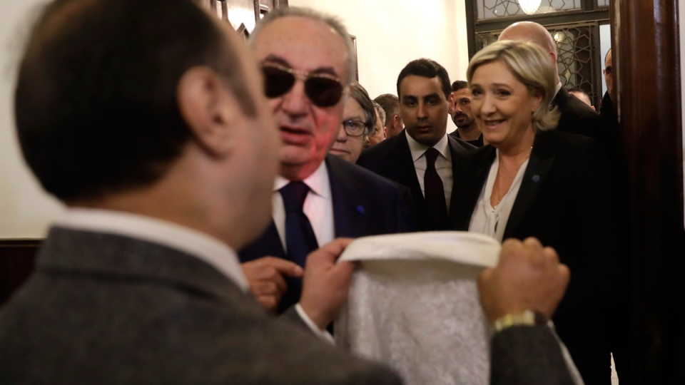 Marine Le Pen refuses to wear a head scarf