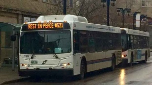 "The signs on the front of the buses read ""Rest in Peace 521,"" in addition to normal route information all day. (Source: Scott Andersson/CTV News)"