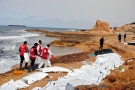 This Monday, Feb. 20, 2017 photo provided by The International Federation of Red Cross and Red Crescent Societies (IFRC), shows the bodies of people that washed ashore and were recovered by the Libyan Red Crescent, near Zawiya, Libya. (Mohannad Karima/IFRC via AP)