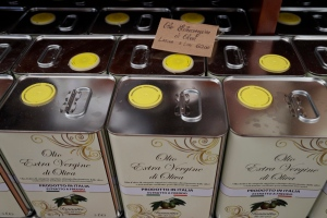 Cans of Italian extra virgin olive oil are on sale at the Iannotta family olive oil farm's shop, in Capocroce, Italy, Thursday, Feb. 16, 2017. From specialty shops in Rome to supermarkets around the world, fans of Italian olive oil are in for a surprise this year as prices are due to jump by as much as 20 percent. (AP Photo/Gregorio Borgia)