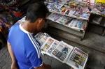 A man looks at newspapers at a minimart in Kuala Lumpur, Malaysia, Sunday, Feb. 19, 2017. (AP / Daniel Chan)