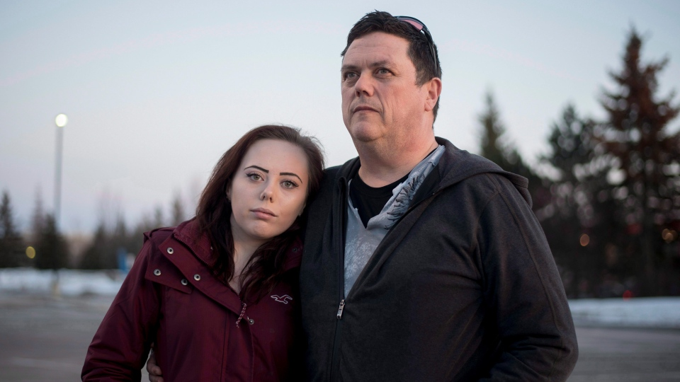 Sean O'Leary stands with his daughter Paige, 16, who has struggled with drug addiction, in the Ottawa suburb of Kanata, Feb. 20, 2017. (Justin Tang/THE CANADIAN PRESS)