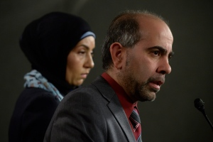Canadian Muslim Forum spokeswoman Samah Jebbari (left) listens as President Samer Majzoub responds to a question during a news conference on Parliament Hill in Ottawa, Tuesday, Feb. 21, 2017. (Adrian Wyld / THE CANADIAN PRESS)