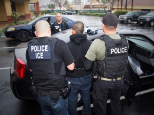 In this photo taken Feb. 7, 2017, released by U.S. Immigration and Customs Enforcement, an arrest is made during a targeted enforcement operation conducted by U.S. Immigration and Customs Enforcement (ICE) aimed at immigration fugitives, re-entrants and at-large criminal aliens in Los Angeles. (Enforcement via AP)