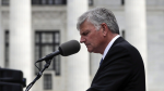 Rev. Franklin Graham prays during an election rally outside the New York state Capitol on Aug. 25, 2016. (AP photo/Mike Groll)