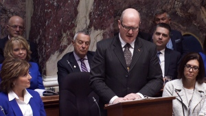Finance Minister Mike de Jong reads details of the provincial budget in Victoria on Tuesday, Feb. 21, 2017.