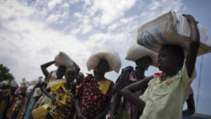 A young girl who fled fighting in nearby Leer in recent months, queues for food aid at a food distribution made by the World Food Programme in Bentiu, South Sudan on Wednesday, Oct. 19, 2016. (Kate Holt / UNICEF)