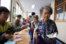 Elderly women wait to cast their ballots in local elections at a polling station in Nonsan, South Korea, Wednesday, June 4, 2014. (AP / Ahn Young-joon)
