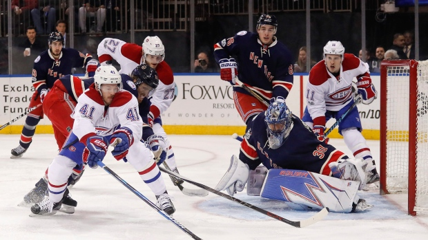 Montreal Canadiens left wing Paul Byron (41) tries to score on New York Rangers goalie Henrik Lundqvist (30) as defenseman Marc Staal (18) helps Lundqvist during the first period of an NHL hockey game, Tuesday, Feb. 21, 2017, in New York. (AP Photo/Julie Jacobson)